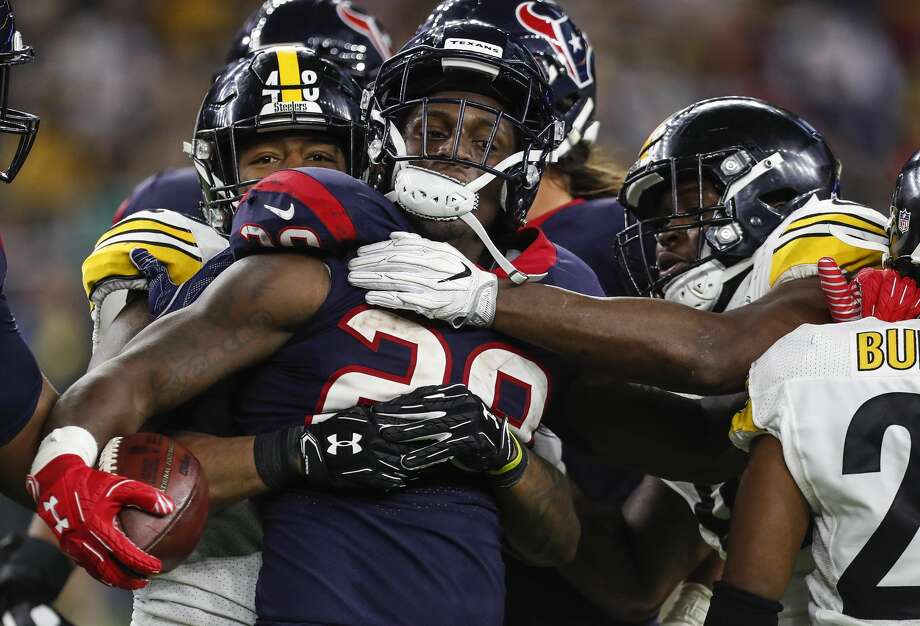 Houston Texans running back Alfred Blue (28) is stopped by the Pittsburgh Steelers defense on a run during the fourth quarter of an NFL football game at NRG Stadium on Monday, Dec. 25, 2017, in Houston. ( Brett Coomer / Houston Chronicle ) Photo: Brett Coomer/Houston Chronicle