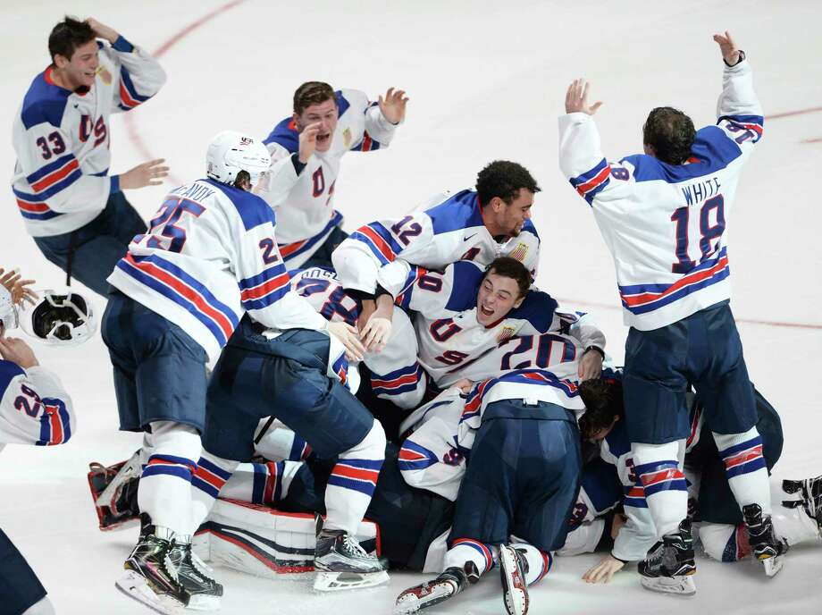 FILE - In this Jan. 5, 2017, file photo, United States players celebrate their victory over Canada in the final of the world junior championship in Montreal. The 10-nation tournament is being played at Buffalo, N.Y., and opens on Tuesday, Dec. 26. It will feature Canada and the U.S. playing an outdoor game at the NFL Buffalo Bills' New Era Field on Friday, Dec. 29. (Paul Chiasson/The Canadian Press via AP, File) Photo: Paul Chiasson / The Canadian Press