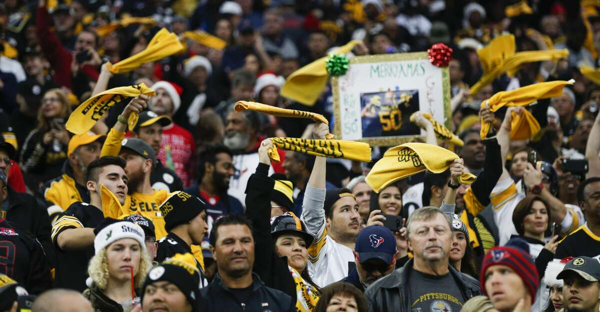 Pittsburgh Steelers fans wave their Terrible Towels during the first quarter of an NFL football game at NRG Stadium on Monday, Dec. 25, 2017, in Houston. ( Brett Coomer / Houston Chronicle )