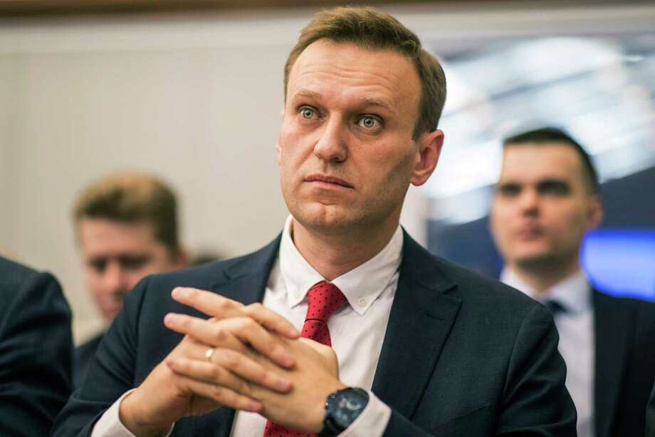 Russian opposition leader Alexei Navalny, who submitted endorsement papers necessary for his registration as a presidential candidate, center, sits at the Russia's Central Election commission in Moscow, Russia, Monday, Dec. 25, 2017. Russian election officials have formally barred Russian opposition leader Alexei Navalny from running for president. (Evgeny Feldman/Navalny Campaign via AP) Photo: Evgeny Feldman / Navalny's campaign