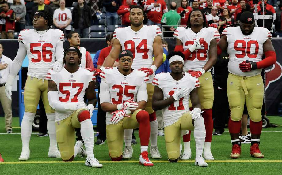FILE - In this Dec. 10, 2017, file photo, San Francisco 49ers San Francisco 49ers' Eli Harold (57), Eric Reid (35) and Marquise Goodwin (11) kneel during the national anthem before an NFL football game against the Houston Texans, in Houston. President Donald Trump's feud with the NFL about players kneeling during the national anthem is the runaway winner for the top sports story of 2017 in balloting by AP members and editors.  (AP Photo/David J. Phillip, File) Photo: David J. Phillip / Copyright 2017 The Associated Press. All rights reserved.