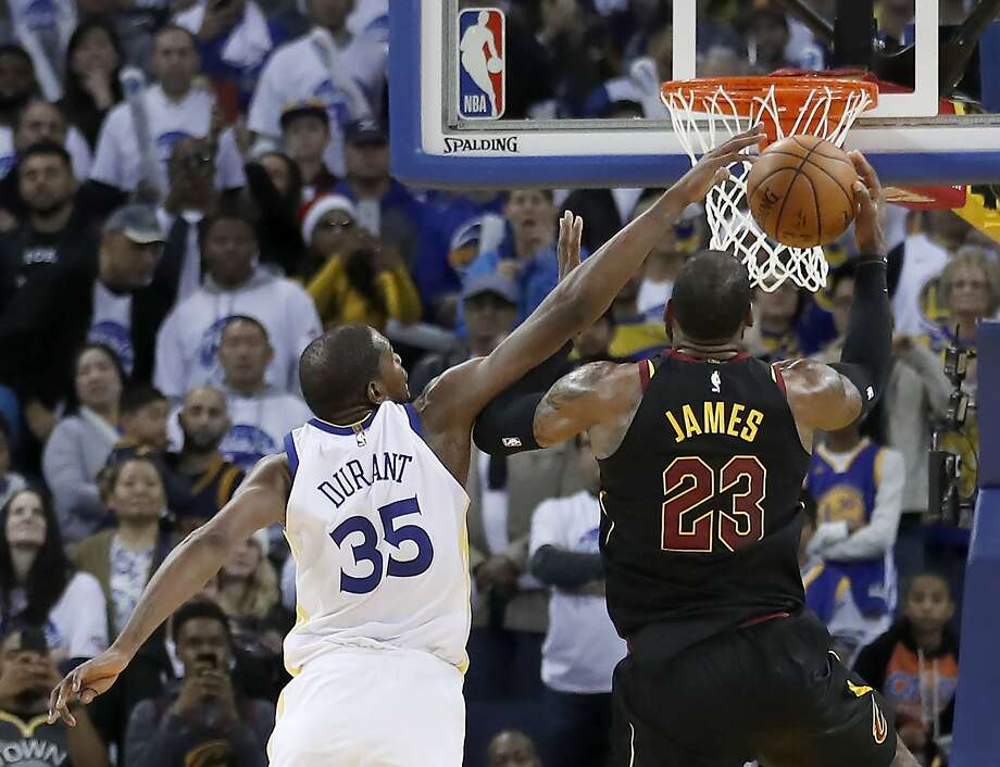 Golden State Warriors forward Kevin Durant (35) blocks Cleveland Cavaliers forward LeBron James (23) shot during the second half of an NBA basketball game in Oakland, Calif., Monday, Dec. 25, 2017. The Warriors won 99-92. (AP Photo/Tony Avelar) Photo: Tony Avelar, Associated Press