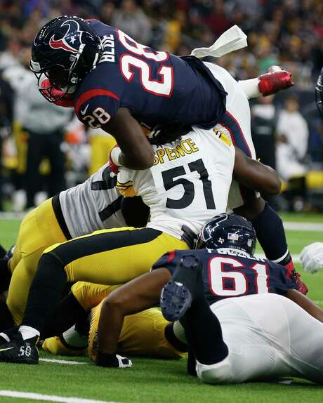 Texans running back Alfred Blue (28) is stopped short of the goal line by Steelers linebacker Sean Spence (51) during the second quarter. Blue carried 16 times for game-high 108 yards. Photo: Brett Coomer, Staff / © 2017 Houston Chronicle