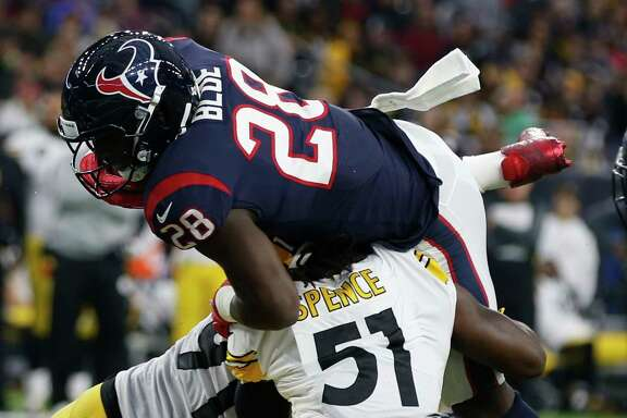 Texans running back Alfred Blue (28) is stopped short of the goal line by Steelers linebacker Sean Spence (51) during the second quarter. Blue carried 16 times for game-high 108 yards.