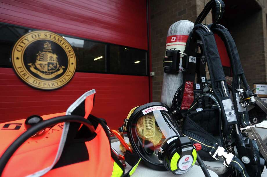 A new Air-Pak X3 breathing apparatus, and accompanying face mask, sit in front of the Stamford Fire Department Headquarters on Main Street before being used in a demonstration in Stamford, Conn., on Tuesday, Nov. 14, 2017. Photo: Michael Cummo / Hearst Connecticut Media / Stamford Advocate