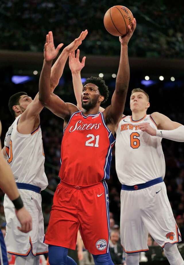 Philadelphia 76ers' Joel Embiid, center, looks for a shot during the second half of the NBA basketball game against the New York Knicks, Monday, Dec. 25, 2017, in New York. The 76ers defeated the Knicks 105-98. (AP Photo/Seth Wenig) Photo: Seth Wenig / Copyright 2017 The Associated Press. All rights reserved.
