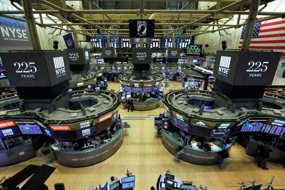 FILE - In this Wednesday, Oct. 18, 2017, file photo, traders work on the floor of the New York Stock Exchange. Wall Street is forecasting another year of gains in 2018, even as warning signals flash that the end may be nearing for one of the stock market's greatest runs in history. (AP Photo/Richard Drew, File) Photo: Richard Drew, STF / AP