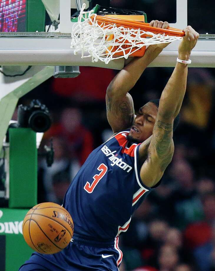 Washington Wizards' Bradley Beal (3) dunks during the second quarter of an NBA basketball game against the Boston Celtics in Boston, Monday, Dec. 25, 2017. (AP Photo/Michael Dwyer) Photo: Michael Dwyer / AP2017