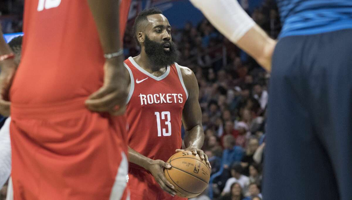 OKLAHOMA CITY, OK - DECEMBER 25: James Harden #13 of the Houston Rockets shoots a free throw agains the Oklahoma City Thunder during the second half of a NBA game at the Chesapeake Energy Arena on December 25, 2017 in Oklahoma City, Oklahoma. The Thunder defeated the Rockets 112-107. NOTE TO USER: User expressly acknowledges and agrees that, by downloading and or using this photograph, User is consenting to the terms and conditions of the Getty Images License Agreement. (Photo by J Pat Carter/Getty Images)