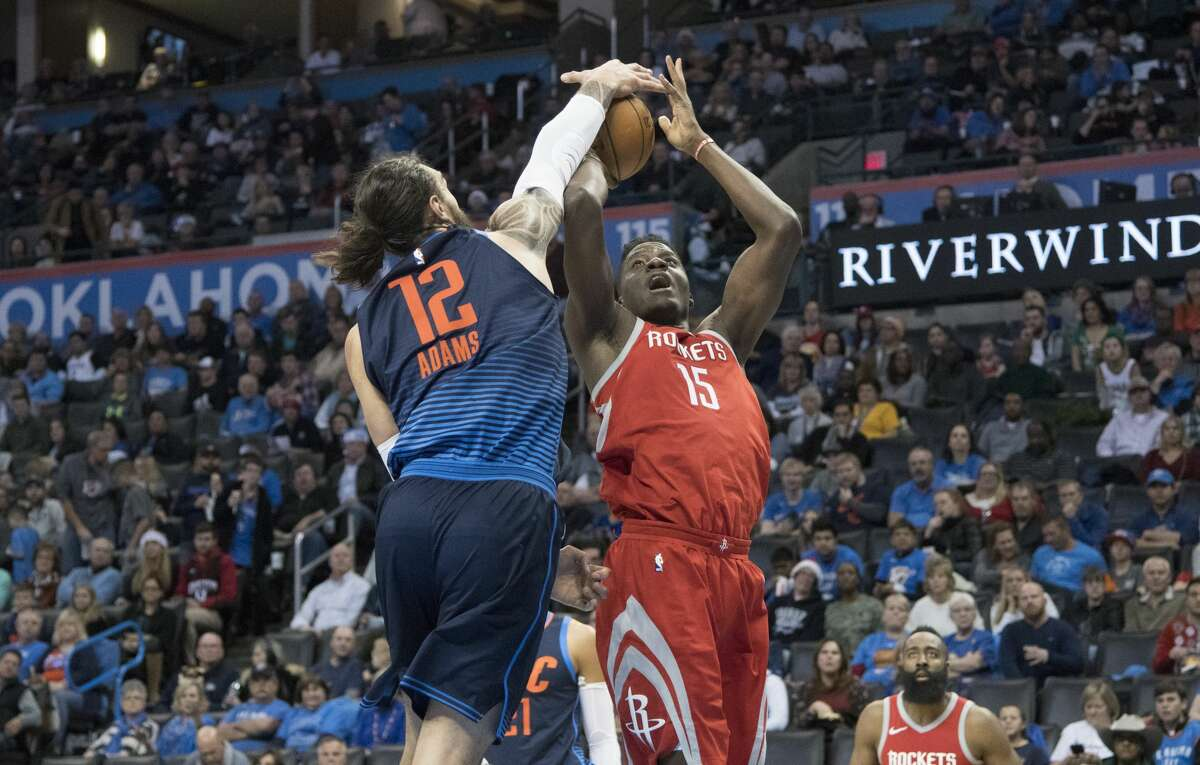 OKLAHOMA CITY, OK - DECEMBER 25: Steven Adams #12 of the Oklahoma City Thunder blocks Clint Capela #15 of the Houston Rockets during the second half of a NBA game at the Chesapeake Energy Arena on December 25, 2017 in Oklahoma City, Oklahoma. The Thunder defeated the Rockets 112-107. NOTE TO USER: User expressly acknowledges and agrees that, by downloading and or using this photograph, User is consenting to the terms and conditions of the Getty Images License Agreement. (Photo by J Pat Carter/Getty Images)