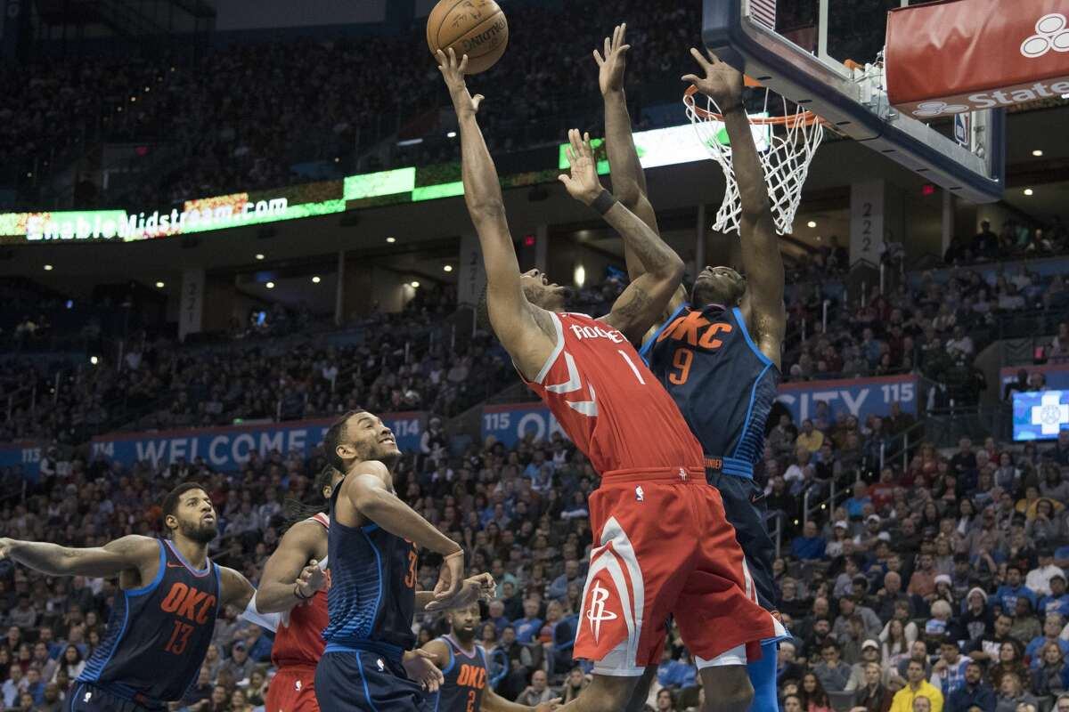 OKLAHOMA CITY, OK - DECEMBER 25: Trevor Ariza #1 of the Houston Rockets shoots around Jerami Grant #9 of the Oklahoma City Thunder during the second half of a NBA game at the Chesapeake Energy Arena on December 25, 2017 in Oklahoma City, Oklahoma. The Thunder defeated the Rockets 112-107. NOTE TO USER: User expressly acknowledges and agrees that, by downloading and or using this photograph, User is consenting to the terms and conditions of the Getty Images License Agreement. (Photo by J Pat Carter/Getty Images)