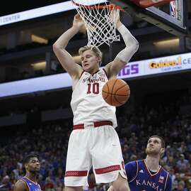 Stanford forward Michael Humphrey dunks against Kansas during the second half of an NCAA college basketball game in Sacramento, Calif., Thursday, Dec. 21, 2017. Kansas won 75-54. (AP Photo/Steve Yeater)