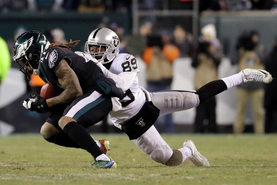 Philadelphia Eagles' Ronald Darby, left, intercepts a pass against Oakland Raiders' Amari Cooper (89) during the second half of an NFL football game, Monday, Dec. 25, 2017, in Philadelphia. (AP Photo/Michael Perez) Photo: Michael Perez / FR168006 AP