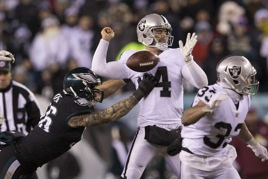 PHILADELPHIA, PA - DECEMBER 25: Chris Long #56 of the Philadelphia Eagles strips the ball from Derek Carr #4 of the Oakland Raiders in the fourth quarter at Lincoln Financial Field on December 25, 2017 in Philadelphia, Pennsylvania. The Eagles defeated the Raiders 19-10. (Photo by Mitchell Leff/Getty Images) Photo: Mitchell Leff, Getty Images