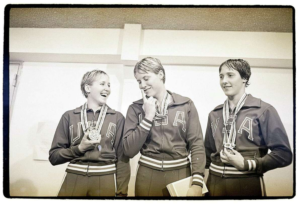 Three American women, Sharon Finneran, left, who won second place, Donna de Varona won first, and Martha Randall took third, stand on the winners' platform after receiving their medals for winning in the women's 400-meter individual medley finals at the 1964 Tokyo games. De Varona's time of 5 minutes 18.7 seconds set a new Olympic record.