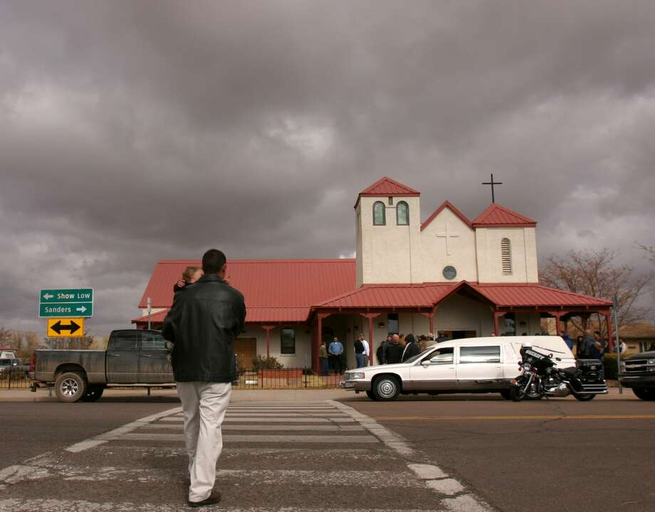 FILE - A man arrives at the funeral  of Vincent Romero at the St. John the Baptist church in St. Johns, Ariz., on Monday morning, Nov.10, 2008. Romero's son was found guilty of shooting and killing him and another man. Photo: Dana Felthauser/AP