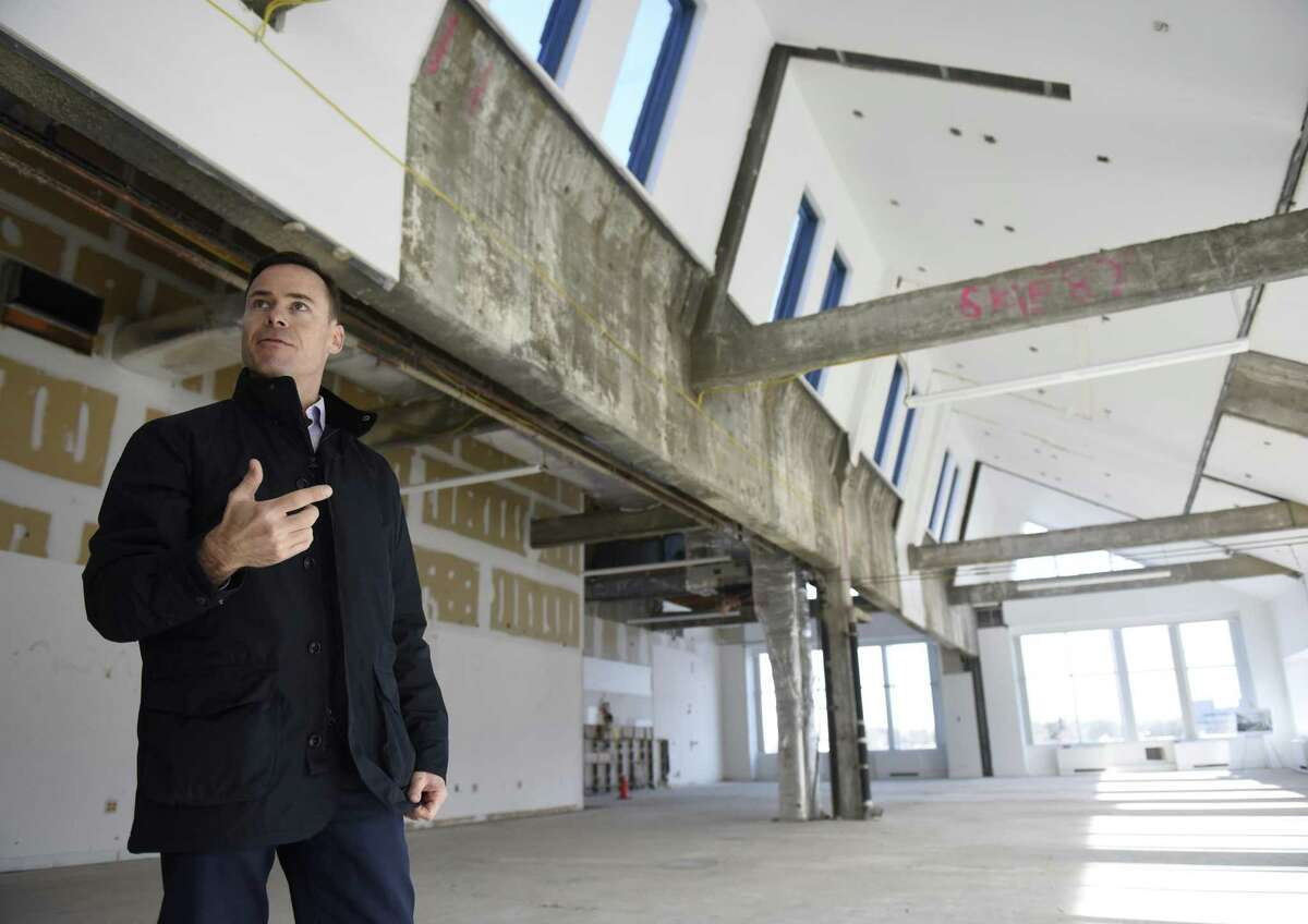 Building and Land Technology Chief Operating Officer Ted Ferrarone shows office space in BLT's Harbor Landing complex on Southfield Avenue in Stamford, Conn., on Wednesday, Dec. 20, 2017. The complex overlooks Stamford Harbor and includes five office buildings, two restaurants, a boardwalk and a marina.
