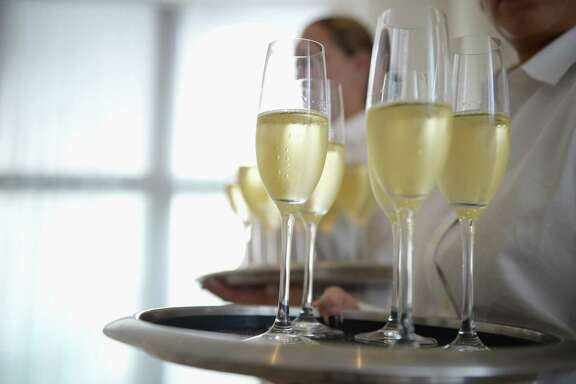 MIAMI BEACH, FL - DECEMBER 07: Welcome Champagne for guests at Room 2022: An Installation By Es Devlin, Presented By American Express Platinum At The Miami Beach EDITION on December 7, 2017 in Miami Beach, Florida.  (Photo by Jason Kempin/Getty Images for American Express Platinum)