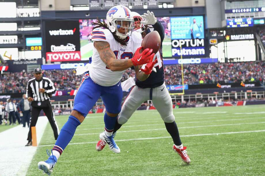 Kelvin Benjamin of the Buffalo Bills catches a touchdown pass as he is defended by Stephon Gilmore of the New England Patriots during a game against the Buffalo Bills at Gillette Stadium on Dec, 24, 2017 in Foxboro, Massachusetts. The touchdown was reversed after an official review. Photo: Maddie Meyer /Getty Images / 2017 Getty Images