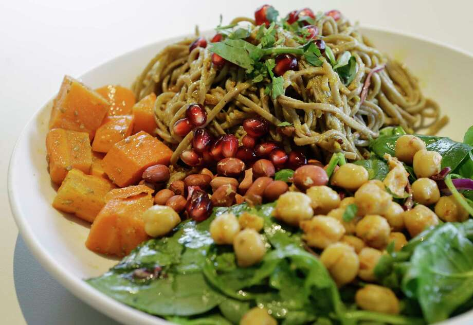 Kerala Noodle Salad features buckwheat noodles tossed with garbanzo beans, pickled carrots, spinach, lime and peanuts. Photo: Melissa Phillip, Houston Chronicle / © 2017 Houston Chronicle