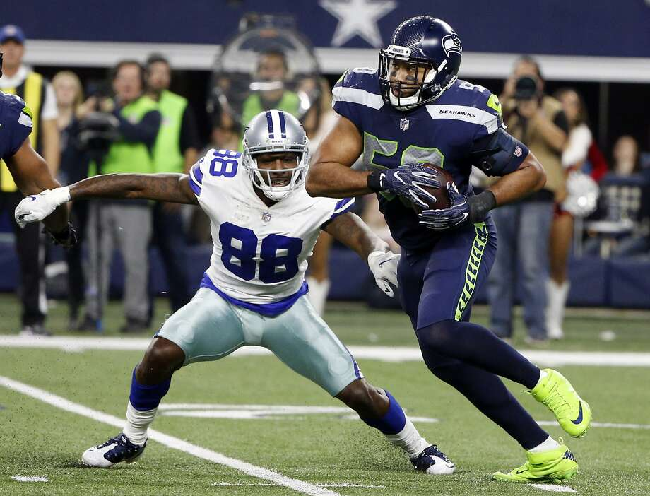 Seahawks linebacker K.J. Wright will donate $300 for every tackle he makes this season toward a clean-water cause in Kenya.  Photo: Michael Ainsworth, Associated Press
