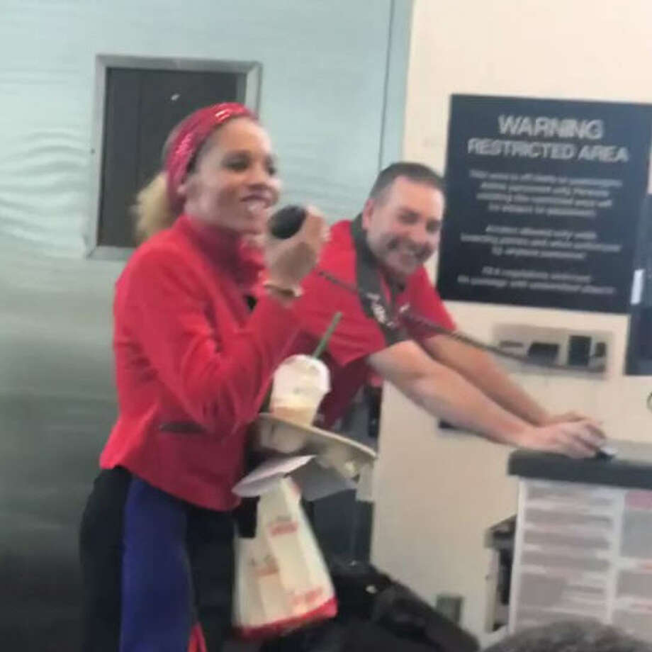 "Southwest employee Charise Miles, 42, serenaded travelers with her own rendition of ""I'll Be Home for Christmas"" on Friday, Dec. 22, 2017. Photo: Suzi Pitts, Twitter"