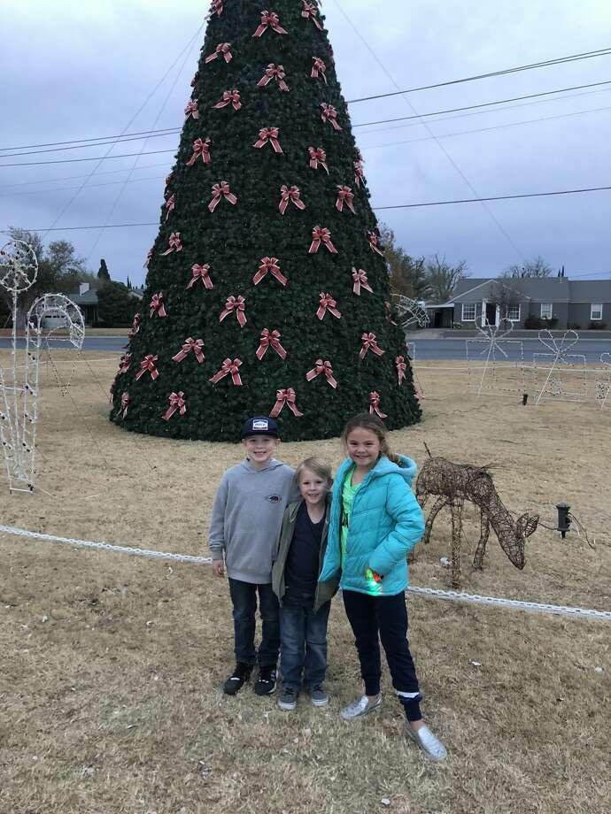 Tree lighting: Branson Edgecomb, from left, Beckett Edgecomb and Audia Kinzler Photo: Courtesy Photo