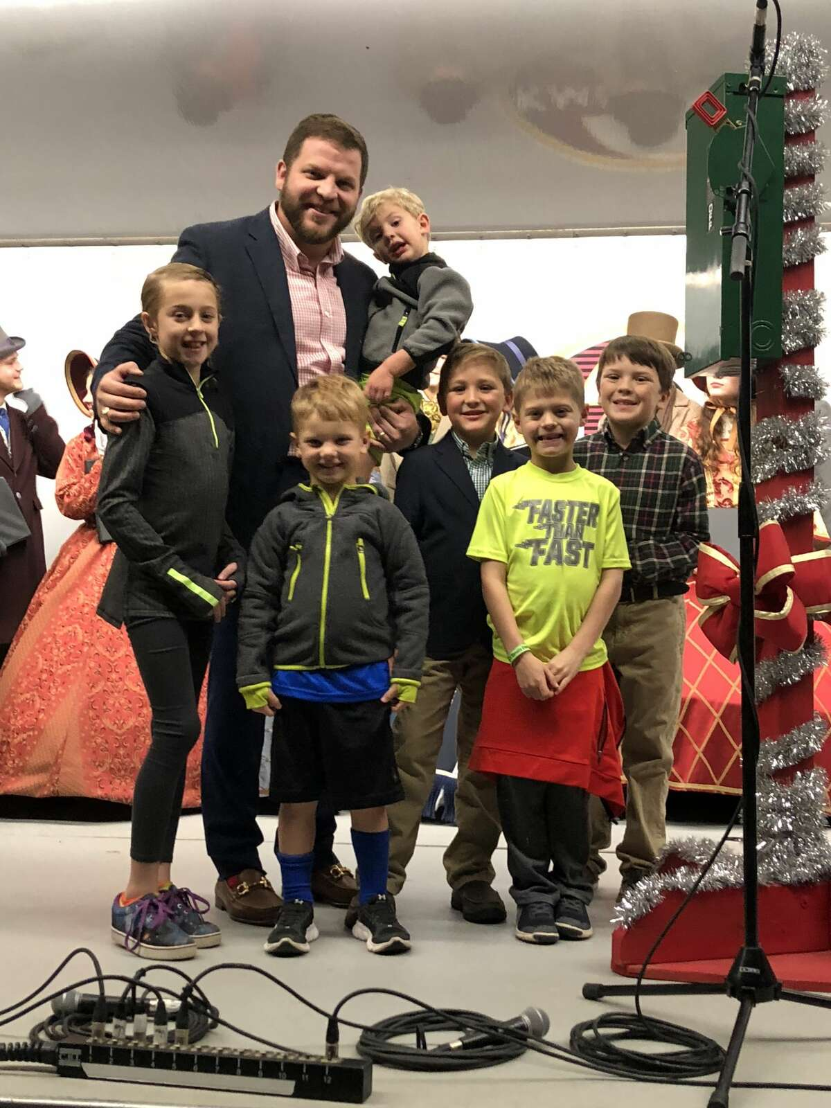 Tree lighting: Spencer Robnett, back row left, and Weston Reeves; and Madison Fietz, front row from left, Cline Reeves, Connor Goodwin, Jett Fietz and Sloan Goodwin