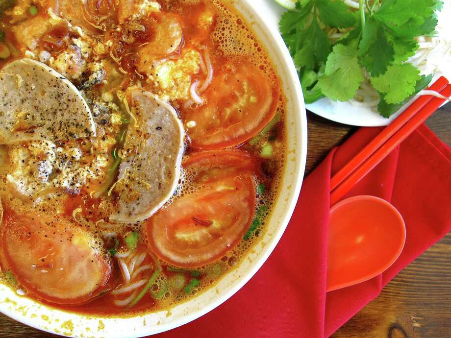 Bun rieu soup with tomatoes, noodles and crumbled cakes of egg, dried shrimp and crab paste from Berni Vietnamese Restaurant. Photo: Mike Sutter /San Antonio Express-News
