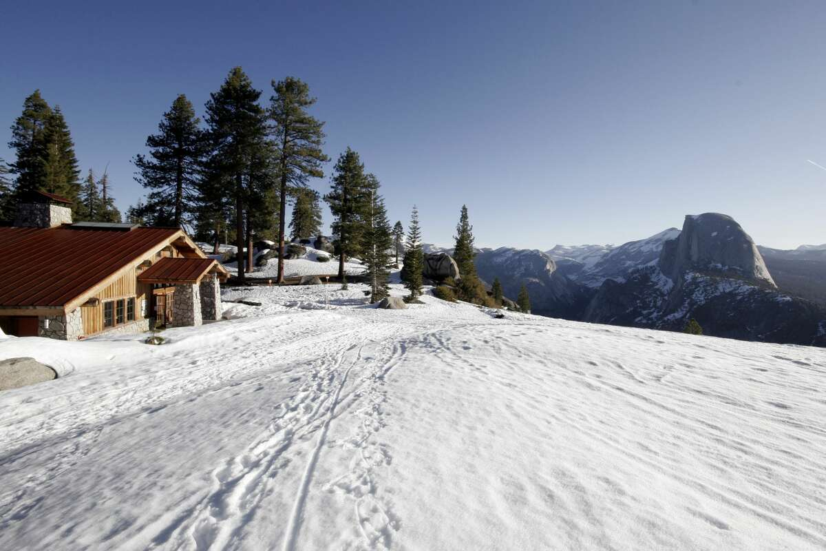 The Glacier Point Ski Hut sits on a cliff high above Yosemite Valley, with views of Half Dome, the high country and the valley far below.