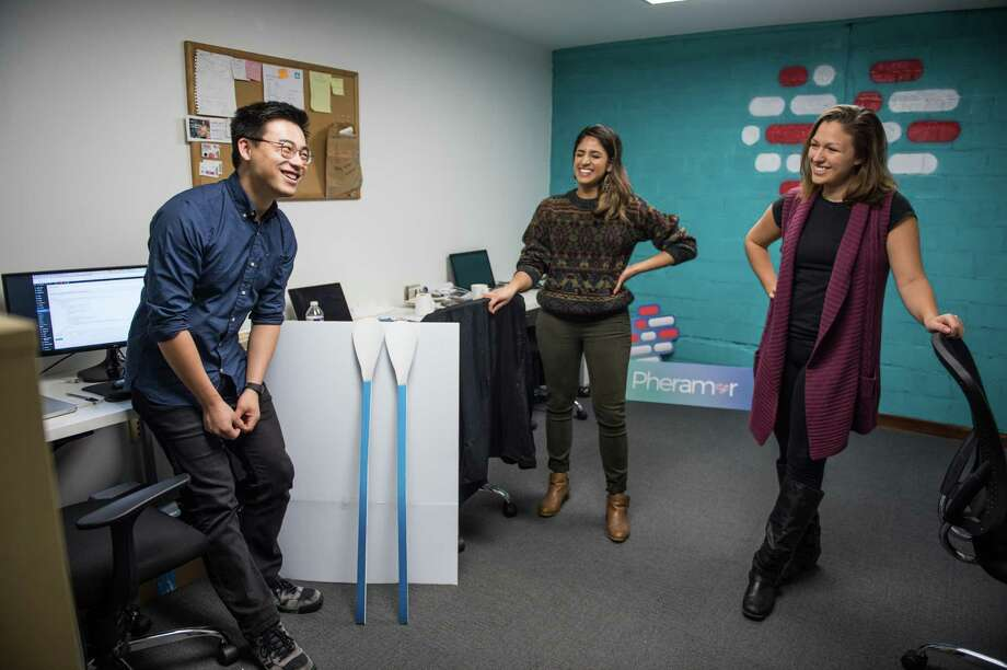 Bin Huang, Asma Mirza, and Brittany Barreto, co-founders of Pheramor, talk in their downtown Houston office Wednesday November 29th. (Michael Starghill, Jr.) Photo: Michael Starghill Jr., Photographer / © Michael Starghill, Jr.