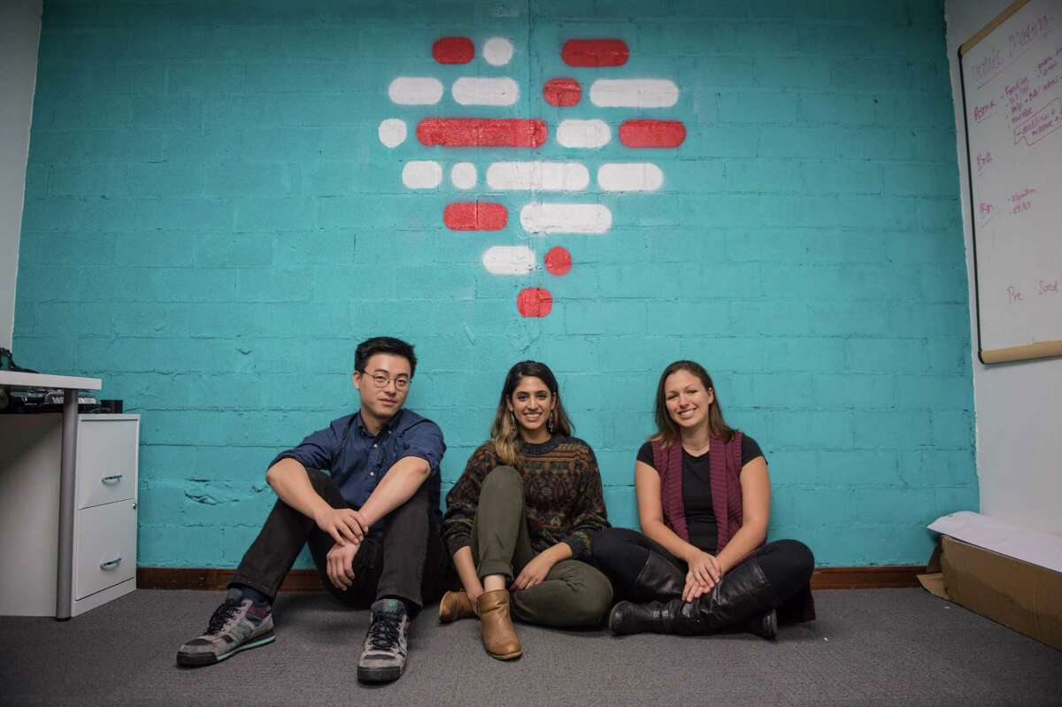 Bin Huang, Asma Mirza, and Brittany Barreto, co-founders of Pheramor, pose for a portrait in their downtown Houston office Wednesday November 29th. (Michael Starghill, Jr.)