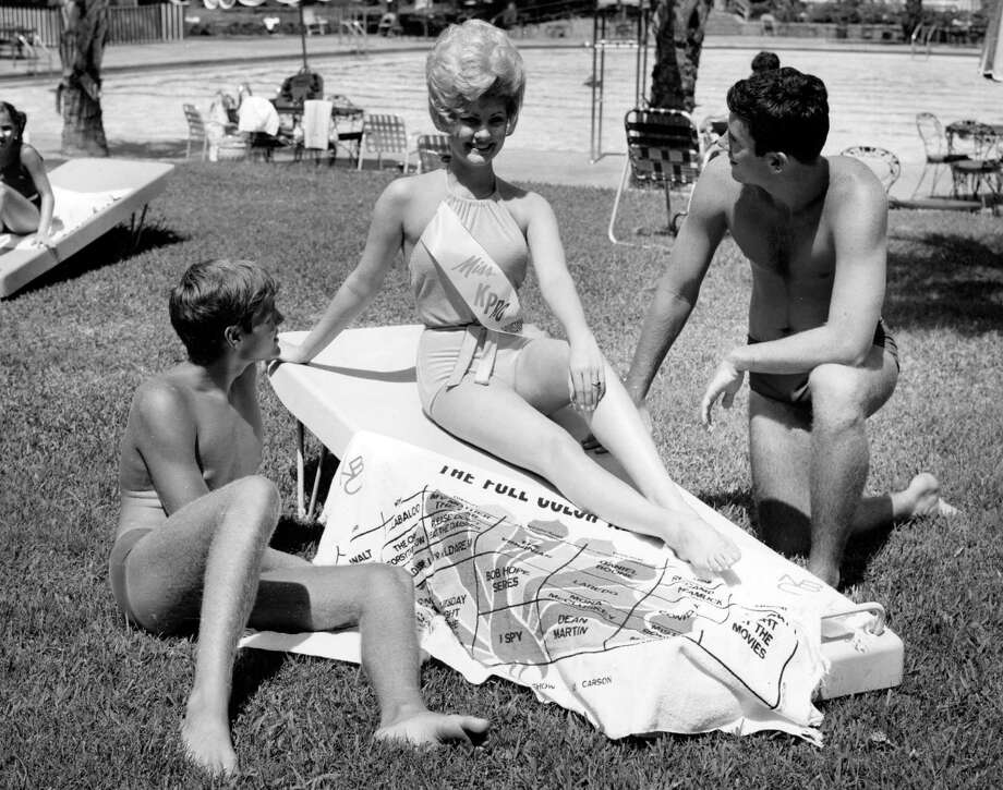 "From the August 1965 Houston Post: ""Sammi Williamson, recently named Miss KPRC, was the safest girl at the Shamrock Hilton swimming pool when she found herself between two admiring lifeguards. The admirers are Pat O'Rourke, left, and Greg Nash. Miss Williamson will be Houston's entry in the Miss Astro 1966 contest to be held at the Harris County Domed Stadium and the Shamrock Thursday through Sunday."" Photo: Unknown, Gulf Photo"
