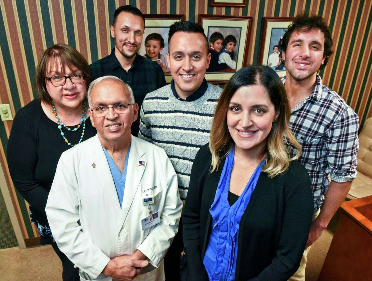 The Syed family of Niskayuna, from left, Anne Marie, Dr. Iftikhar, Noah, Solomon, Yasmine and Jacob, pose for a family photo in Dr. Syed's Ellis Hospital office Saturday Dec. 2, 2018 in Schenectady, NY. (John Carl D'Annibale / Times Union)