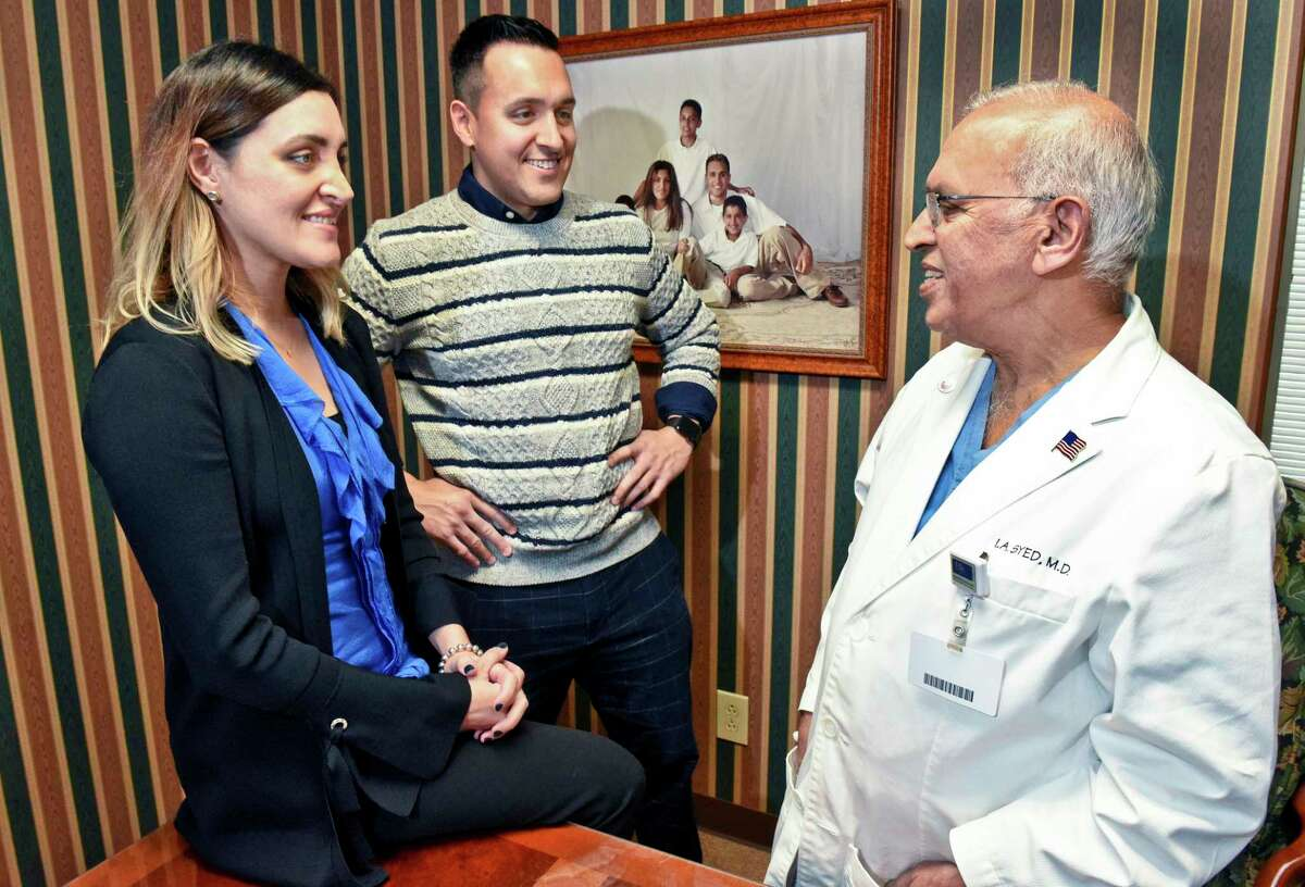 Dr. Iftikhar Syed, right, of Niskayuna, with his daughter Yasmine and son Solomon in his Ellis Hospital office Saturday Dec. 2, 2018 in Schenectady, NY. (John Carl D'Annibale / Times Union)