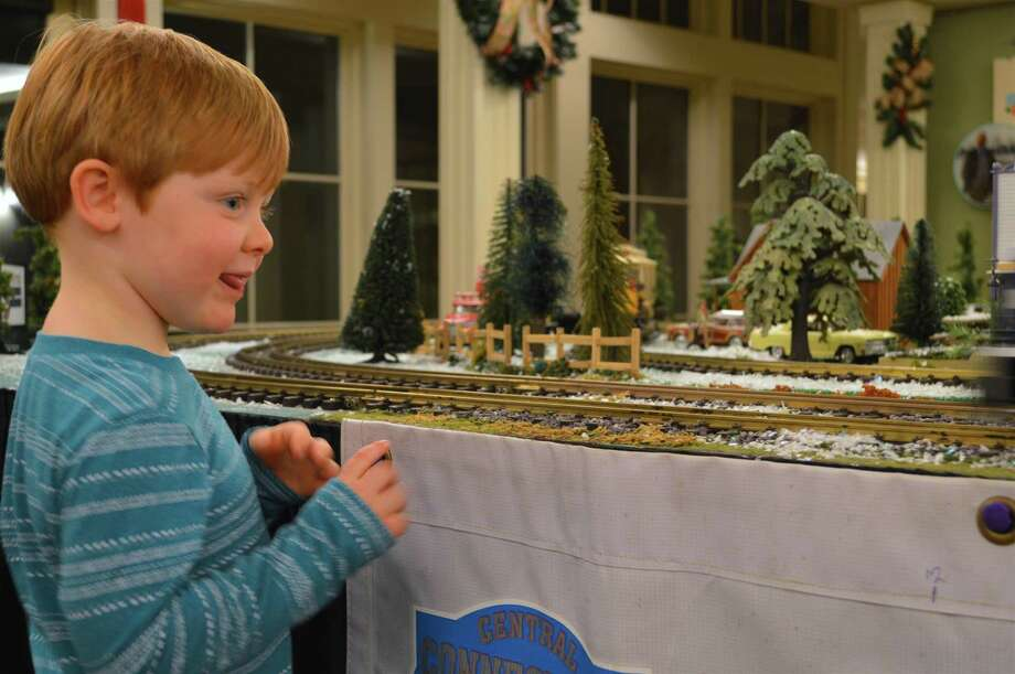 Ben Menwaring, 4, of Fairfield, enjoys the toy trains at the Fairfield Museum and History Center's holiday crafts and train show event, Friday, Dec. 22, 2017, in Fairfield, Conn. Photo: Jarret Liotta / For Hearst Connecticut Media / Fairfield Citizen News Freelance