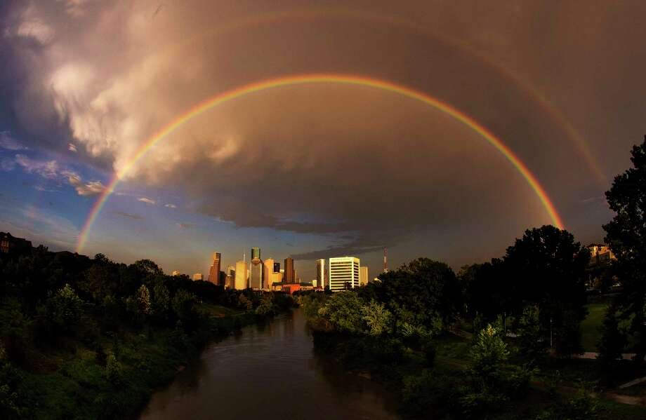 A double rainbow sits over the Houston skyline after heavy storms passed through the area July 8, 2017. ( Michael Ciaglo / Houston Chronicle ) Photo: Michael Ciaglo, Staff / Internal