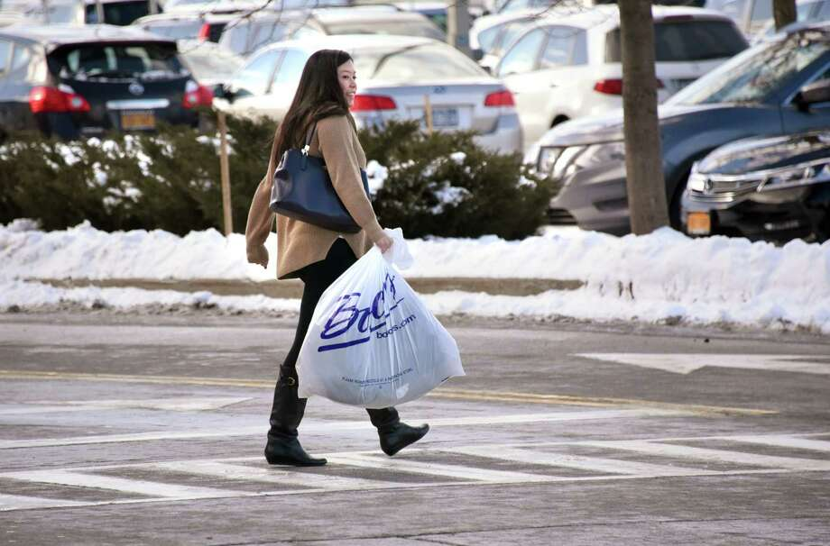 A woman walks back to her car after shopping at Colonie Center on Tuesday, Dec. 26, 2017 in Colonie, N.Y. After-Christmas sales and returns make this a busy shopping day. (Lori Van Buren / Times Union) Photo: Lori Van Buren, Albany Times Union / 20042499A