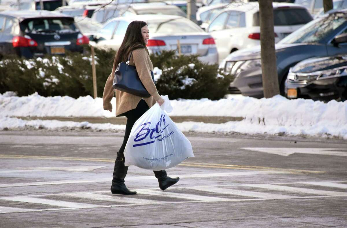 A woman walks back to her car after shopping at Colonie Center on Tuesday, Dec. 26, 2017 in Colonie, N.Y. After-Christmas sales and returns make this a busy shopping day. (Lori Van Buren / Times Union)