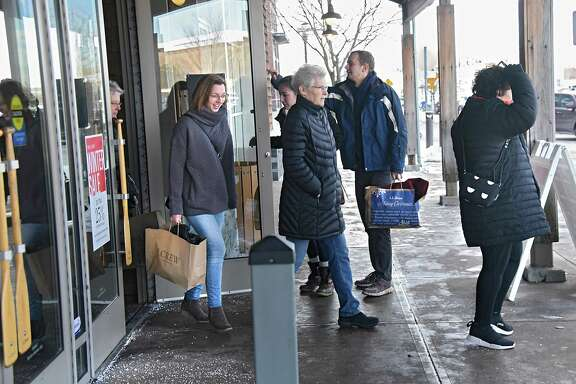 Shoppers with bags come and go at L.L. Bean at Colonie Center on Tuesday, Dec. 26, 2017 in Colonie, N.Y. After-Christmas sales and returns make this a busy shopping day. (Lori Van Buren / Times Union)