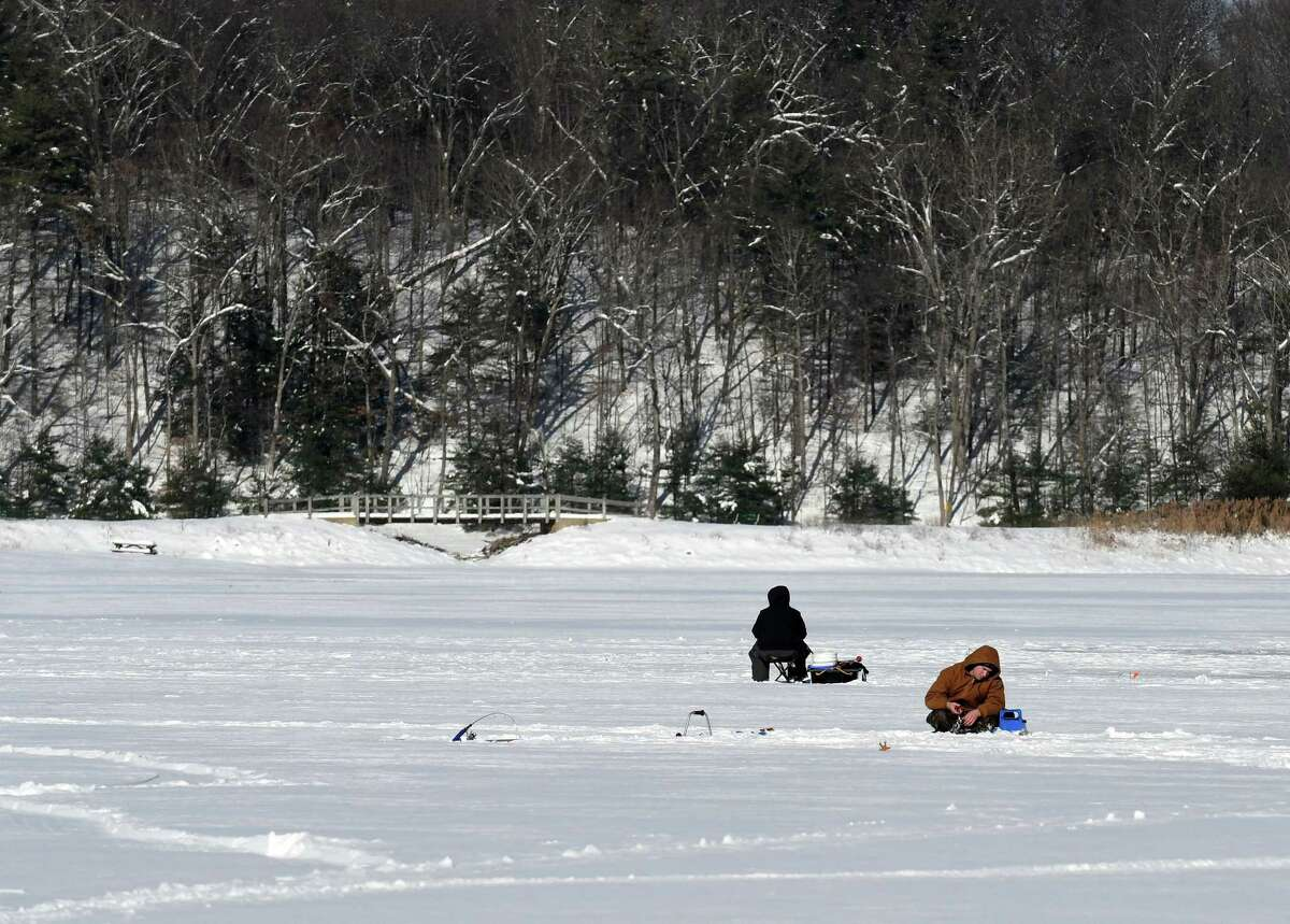 The frozen waters of Moreau Lake attracted a few hardy anglers for ice fishing on Tuesday, Dec. 26, 2017, at Moreau Lake State Park in Moreau, N.Y. In recent years, the lake has dropped as much as five feet, representing tens of millions of gallons of absent water. (Will Waldron/Times Union)