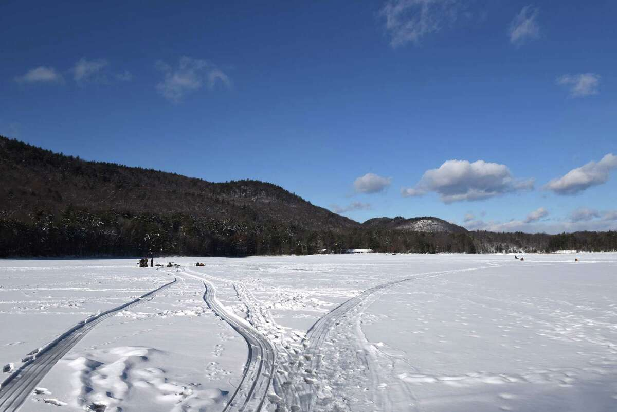 In 2017, Moreau Lake in Saratoga County attracted a few hardy anglers for ice fishing. The popular sport will get special attention in February with a Warren County initiative. (Will Waldron/Times Union)