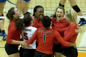 The Woodlands celebrates after defeating Klein 28-26 during the second set of a Region II-6A semifinal volleyball match at Johnson Coliseum, Friday, Nov. 10, 2017, in Huntsville. The Woodlands defeated Klein in straight sets.
