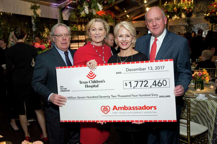 On Dec. 13, more than 300 guests gathered at the home of Marcia and Brig Smart to celebrate the eighth annual Ambassadors for Texas Children's Hospital Holiday Party. Pictured here are Mike and Carol Linn, and Helen and Dr. Charles Fraser. Photo: Jenny Antill And Chinh Phan / JennyAntill
