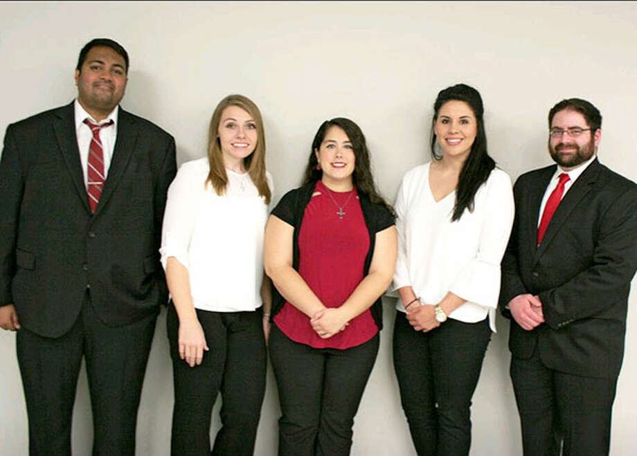 Neilesh Vora, left, Stephanie Kelley, Ashley Garrett, Natalie Lazo and Christopher Nowzaradan stand together on Dec. 2 after their team received first place in the 22nd UHV Bachelor of Business Administration Case Conference. This year's competition required students to analyze and create a presentation about Kimberly-Clark Corp. Photo: Courtesy Photo