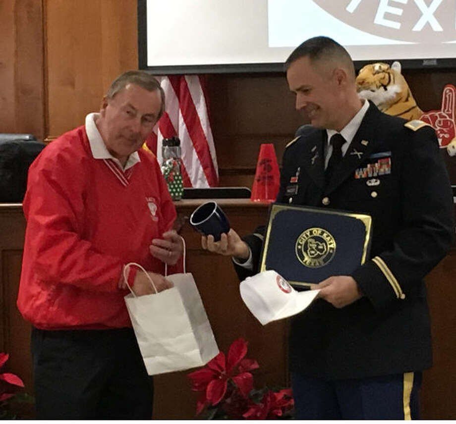 "Katy Mayor Chuck Brawner honored Col. Scott M. MacLeod, commander of the 136th Maneuver Enhancement Brigade, Texas National Guard, on Dec. 11 with an ""Above & Beyond"" certificate of recognition as a Harvey's Hero. The mayor also presented him with other Katy items, including a T-shirt for the Katy Tigers football team. MacLeod led National Guardsmen based at the Katy High School library in recovery efforts throughout the Gulf Coast to the Louisiana border after Hurricane Harvey.      Katy Mayor Chuck Brawner honored Col. Scott M. MacLeod, commander of the 136th Maneuver Enhancement Brigade, Texas National Guard, on Dec. 11 with an ""Above & Beyond"" certificate of recognition as a Harvey's Hero. The mayor also presented him with other Katy items, including a T-shirt for the Katy Tigers football team. MacLeod led National Guardsmen based at the Katy High School library in recovery efforts throughout the Gulf Coast to the Louisiana border after Hurricane Harvey. Photo: Karen Zurawski"