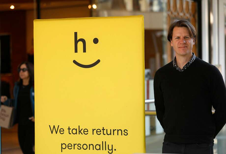 David Sobie, a co-founder of Happy Returns, staffs a return bar at Santa Mon i ca Place. The startup handles returns to online retailers at no cost to shoppers. Photo: Genaro Molina, TNS