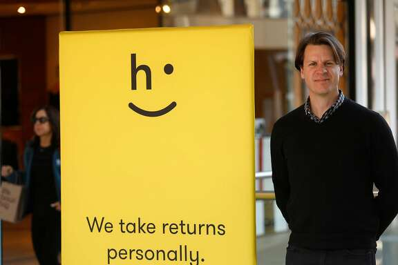 "David Sobie, a co-founder of Happy Returns, stands at a ""return bar"" for customers who wish to return online purchases on Dec. 15, 2017 at Santa Monica Place in Santa Monica, Calif. Happy Returns has set up at dozens of malls across the country, where people can do immediate returns for items purchased online. (Genaro Molina/Los Angeles Times/TNS)"