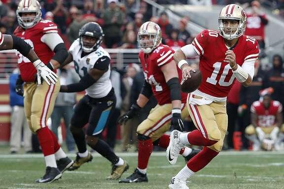San Francisco 49ers quarterback Jimmy Garoppolo (10) against the Jacksonville Jaguarsduring the second half of an NFL football game in Santa Clara, Calif., Sunday, Dec. 24, 2017. (AP Photo/Tony Avelar)