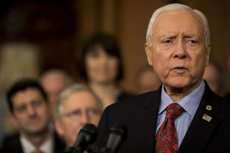 Senator Orrin Hatch, a Republican from Utah, speaks during a Tax Cuts and Jobs Act enrollment ceremony at the U.S. Capitol in Washington, D.C., U.S., on Thursday, Dec. 21, 2017. Republicans want to channel momentum from the GOP's victory on taxes into a push to overhaul the nation's welfare programs, though some of President Donald Trump's advisers prefer a less controversial infrastructure plan at the top of his agenda. Photographer: Aaron P. Bernstein/Bloomberg Photo: Aaron P. Bernstein, Bloomberg